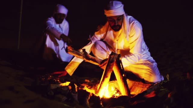 Arabs lighting up the Bonfire in the Desert