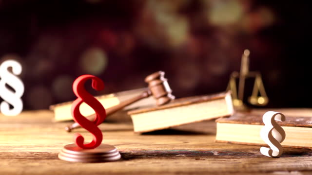 arbitrate concept, dolly shot law theme concept, gavel, books, paragraphs and justice scale sentencing stock videos & royalty-free footage