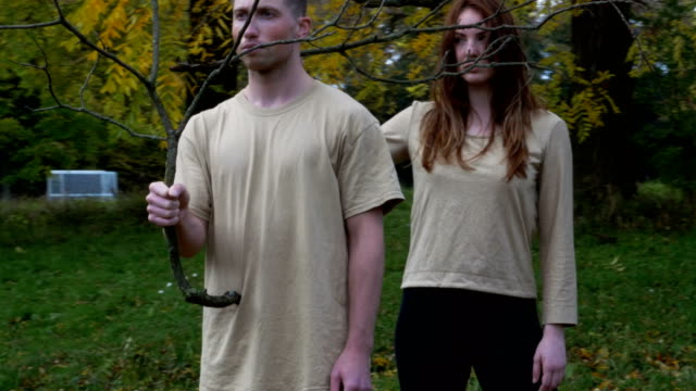 Arc Portrait of Girl and Boy Holding Bare Branches video