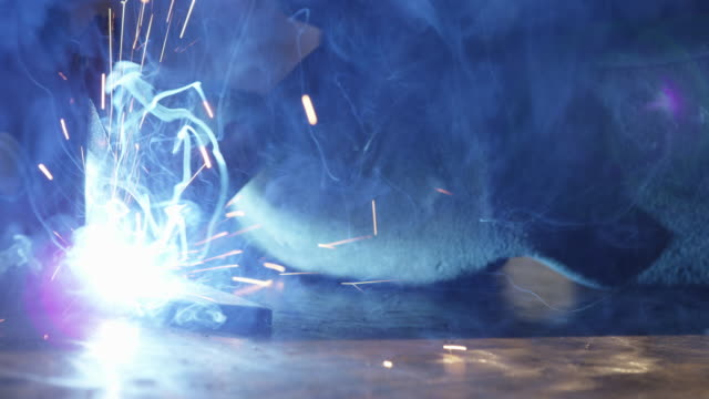 Arc welding smoke and sparks fly 2 Close up arc welding with MIG welder gun sparks fly metal worker stock videos & royalty-free footage