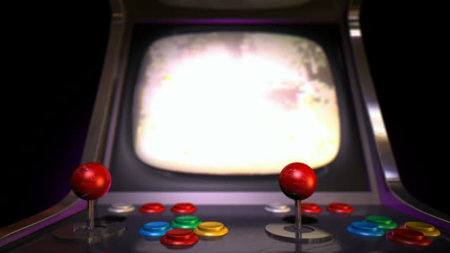 arcade machine pan across game over rack focus video