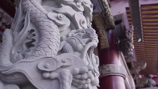 A arch camera take of a dragon stone carving column in court of a temple in Taiwan.
