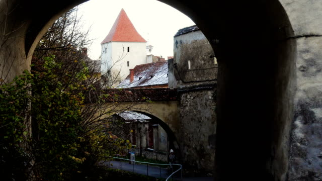arch gates and small street at the ancient town wall, Brasov, Romania video