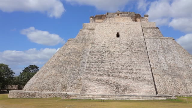 Archaeological sites of Pyramid of the Magician in Maya ruin complex of Uxmal an Mayan step pyramid ( Muul Waay - Maya culture) in Mexico
