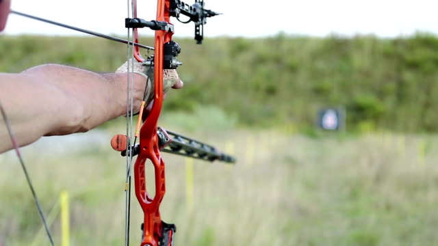 Archer shooting a bow at a target video