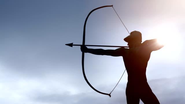 vidéos et rushes de archer avec soleil, time lapse - tir à l'arc