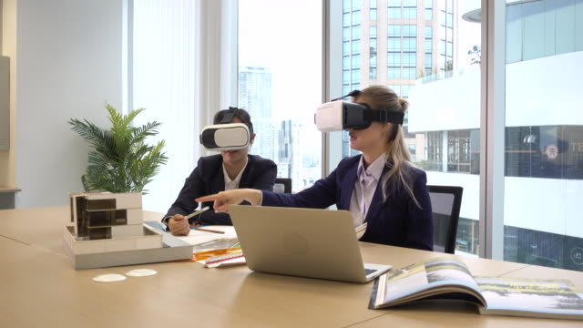 Architect and client Wearing Augmented Reality Headsets in a meeting having a virtual walkthrough