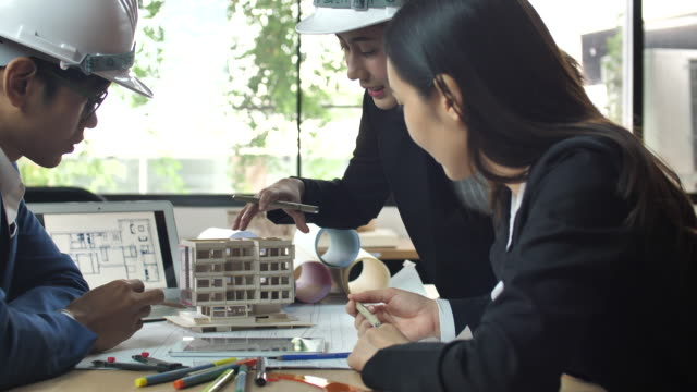 Architect and colleague constructing an architectural model video