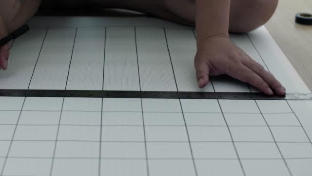 CU : Architect builder woman drawing blueprints video