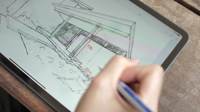 architect comment the details of house plan on digital tablet - architetto video stock e b–roll