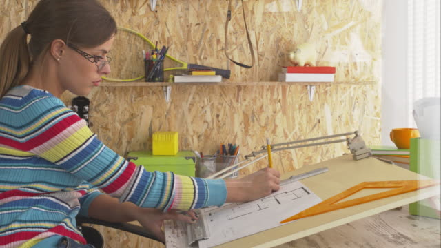 Architect drawing blueprint in office video