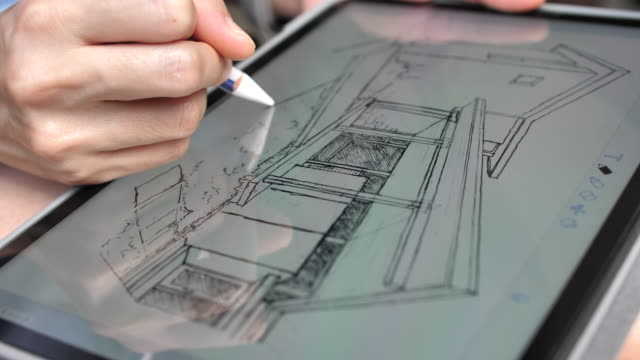 Architect Drawing sketch home on Digital tablet