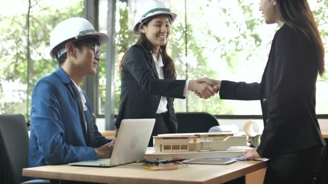 Architect handshake with Customer Architect handshake with Customer businesswear stock videos & royalty-free footage