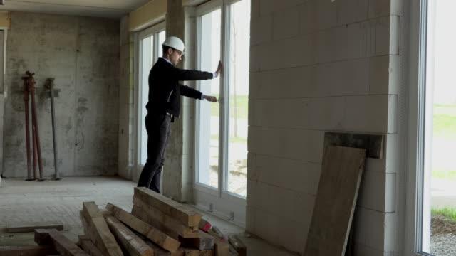 architect inspects construction from the inside - ispettore della qualità video stock e b–roll