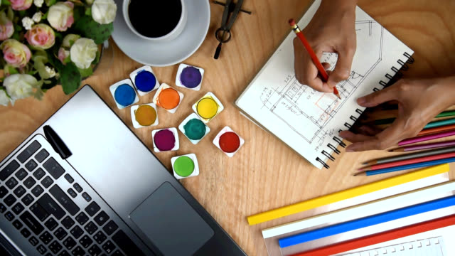 Architect & interior designer drawing on notebook with laptop, cup of coffee, folders / business conceptual Architect & interior designer drawing on notebook with laptop, cup of coffee, folders / business background & conceptual interior designer stock videos & royalty-free footage