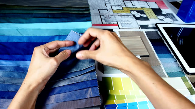 Architect & interior designer working Top view of architect & interior designer hands working with hand-drawn illustration and material sample / Home renovation & improvement concept interior designer stock videos & royalty-free footage