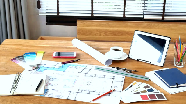 architect interior designers working table video - How Interior Designers Work