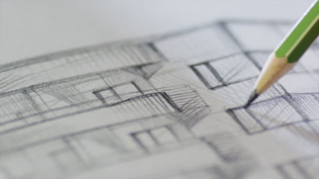 architect is sketching a building on paper - architetto video stock e b–roll