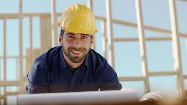 Architect looking at camera at construction site video