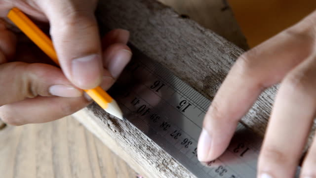 architect measuring wood with ruler video