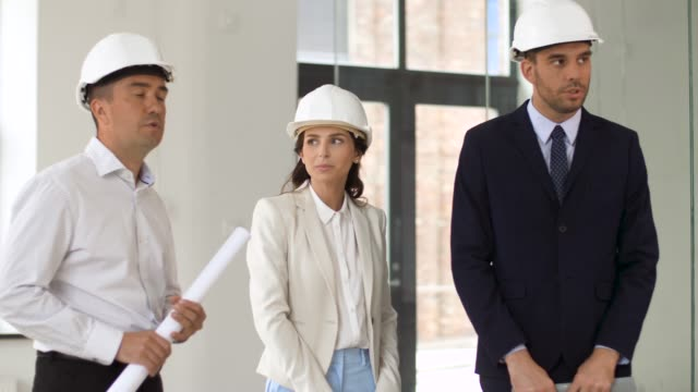 architect or realtor showing office to customers