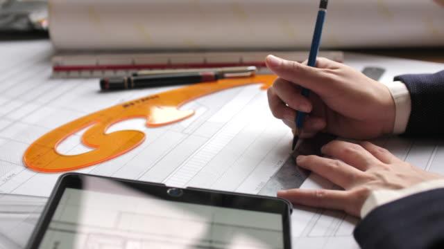 Architect starting draws a house blueprint, Closeup