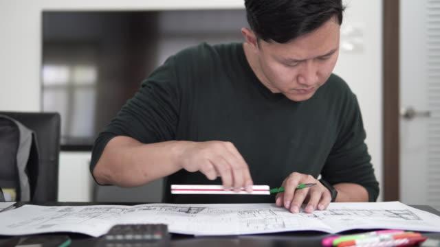Architect starting draws a plan blueprint.