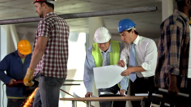HD: Architect Talking With Construction Engineer video