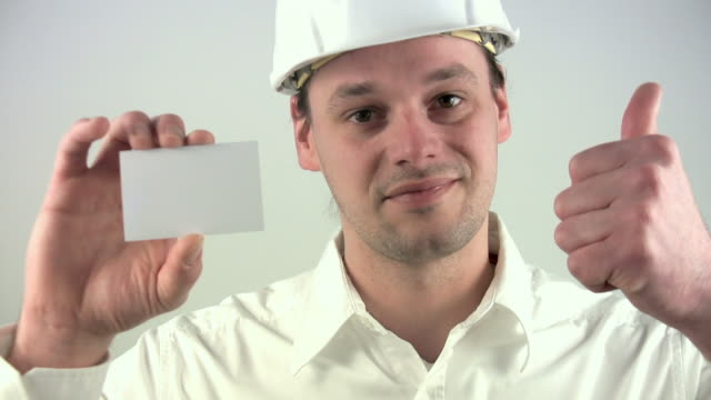 "architect ""thumbs up & business card"" - business card stock videos & royalty-free footage"