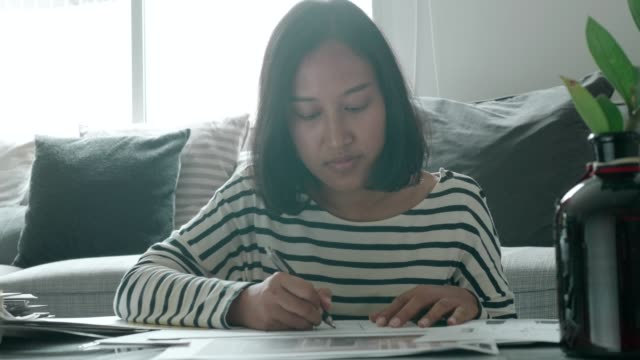 Architect woman working with lay out plan video