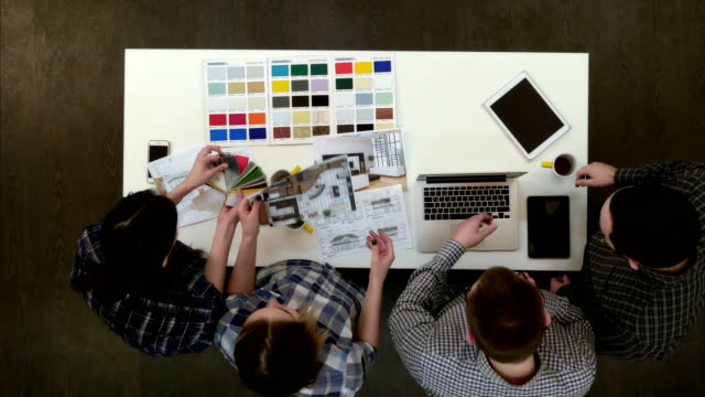 architects and designers working and multitasking in the office - designers video stock e b–roll