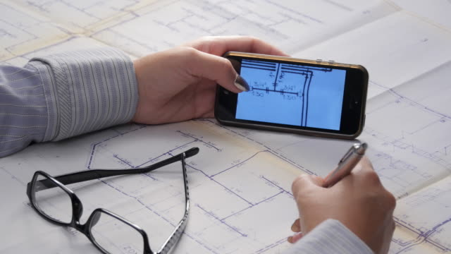 Architect's Hands and Touch Screen Over a Blueprints video