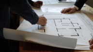 istock Architects looking at plans 1185424624