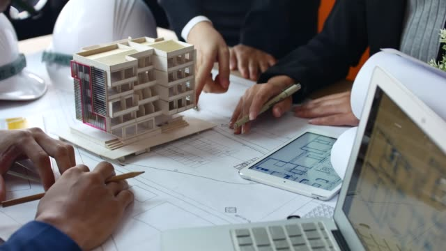 architects team brainstorming the design solutions with architect model - designers video stock e b–roll