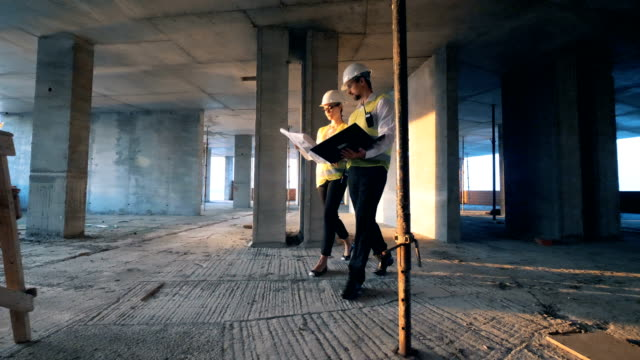 architects walking inside a building, close up. - industria edile video stock e b–roll