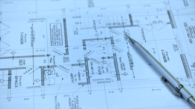 Architectural blueprints and blueprint rolls with drawing instruments video