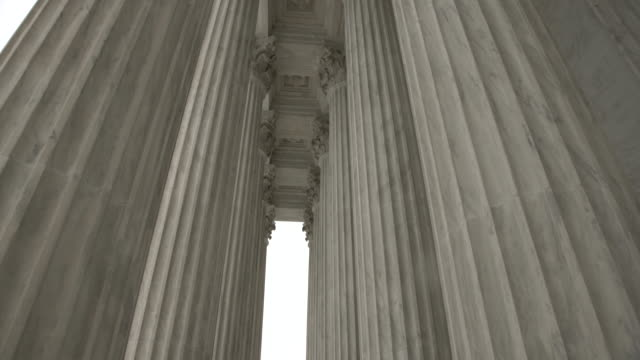 Architectural Columns of the Supreme Court of the United States in Washington, DC Tilt Up Shot of the Columns of the United States Supreme Court in Washington DC - supreme court stock videos & royalty-free footage