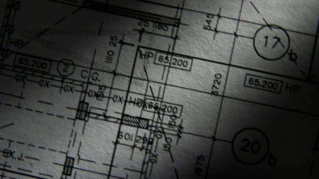 Architectural Plans Pan Dramatic Lighting video