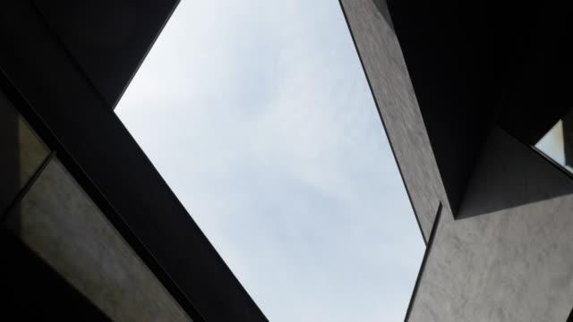 architecture angles and sky - бетон стоковые видео и кадры b-roll