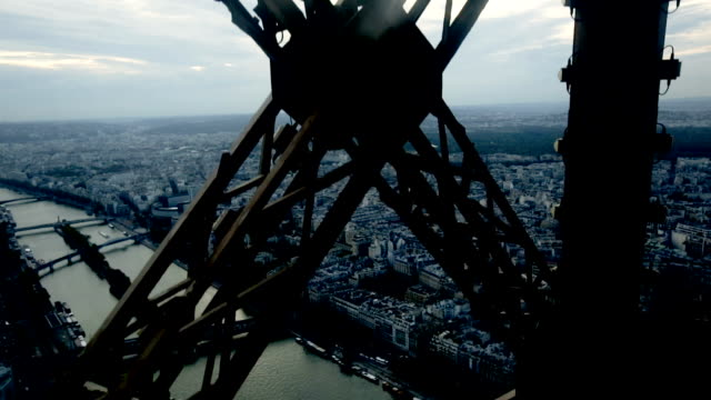 Architecture of Eiffel Tower Architecture of Eiffel Tower. Closeup view of metal frames, beams, rivets against blue sky as background metalwork stock videos & royalty-free footage