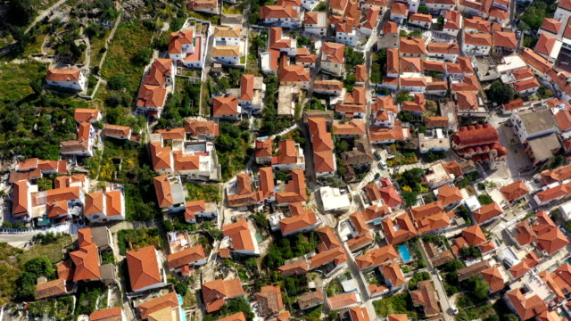 architecture of Porose island in Greece. tiled roofs of the old European city. Aerial video footage - video