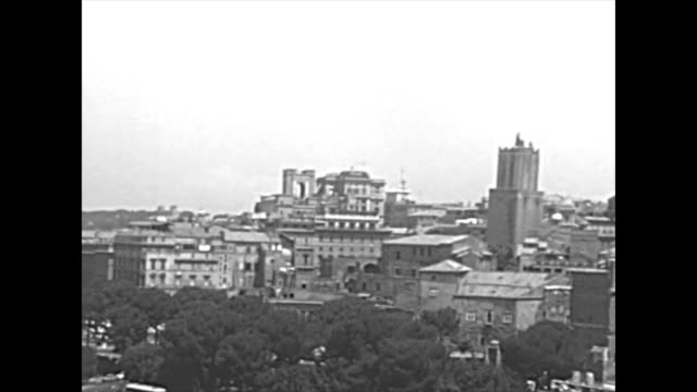 archival aerial view of Roman Forum Aerial view of the churchs Santi Luca e Martina and San Lorenzo in Miranda, Altar of the Fatherland and Trajan Forum. Roman Forum in Rome city. BW historical archival of Rome capital of Italy in 1960s 20th century stock videos & royalty-free footage
