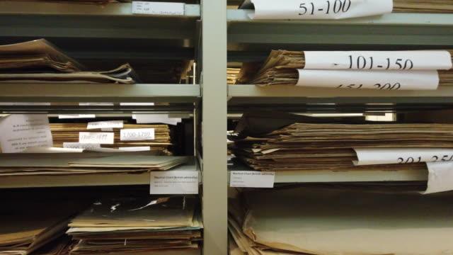 archive filing room - schedario documento video stock e b–roll