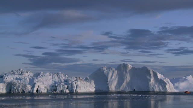 Arctic seascape with iceberg and small ship video