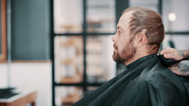Are you ready to level up? 4k video footage of a young man getting ready for a treatment at a barbershop small business saturday stock videos & royalty-free footage