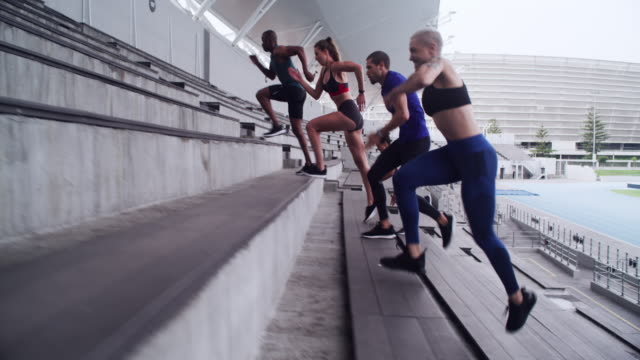 Are you up for the cardio challenge? 4k video footage of a group of athletes running up a staircase at a sports arena athleticism stock videos & royalty-free footage