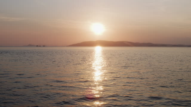 Areal View of the Sun Setting Over a Calm Sea, Komodo Indonesia