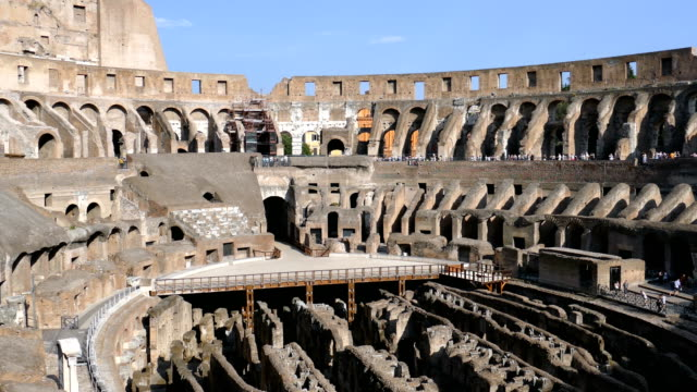 arena coliseum at evening time, with tourists inside - stile classico romano video stock e b–roll