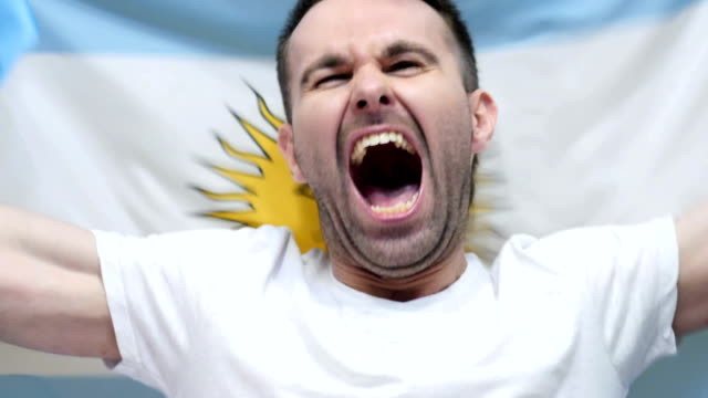 Argentinian Fan celebrates holding the Flag of Argentina in Slow Motion ,4k , high quality video