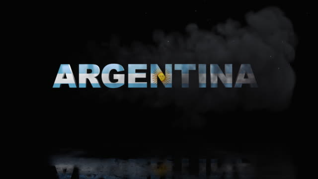 argentinian flag on title is revealing with fire - bandiera dell'argentina video stock e b–roll